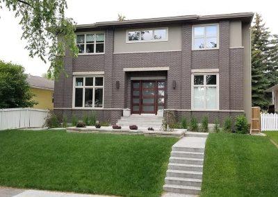 Rectangular home with many windows