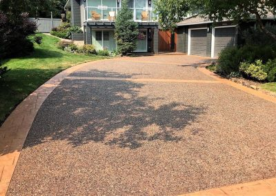 Orange Coloured Concrete Driveway