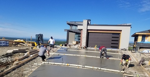 Men Pouring Cement on Driveway
