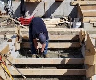 Man Building Concrete Steps