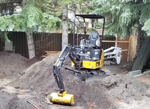 Small Tractor Digging Dirt